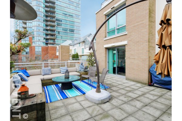Fully Furnished 2 Bed Apartment Rental With Huge Patio at The Brighton in Vancouver. 303 - 120 Milross Avenue, Vancouver, BC, Canada.